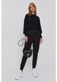 Silvian Heach - Spodnie. Okazja: na co dzień. Kolor: czarny. Materiał: tkanina. Styl: casual