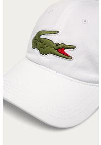 Biała czapka z daszkiem Lacoste z aplikacjami