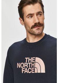Niebieska bluza nierozpinana The North Face bez kaptura, z aplikacjami, na co dzień