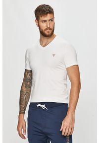 Biały t-shirt Guess Jeans casualowy, z aplikacjami, na co dzień