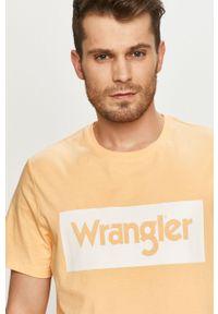 Pomarańczowy t-shirt Wrangler na co dzień, casualowy, z nadrukiem