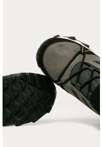 Zielone buty zimowe adidas Performance z cholewką, z nadrukiem, z okrągłym noskiem