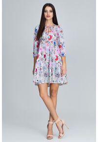 e-margeritka - Sukienka w kolorowe kwiaty wiązana pod szyją - l/xl. Materiał: poliester, materiał, elastan. Wzór: kwiaty, kolorowy. Sezon: lato, wiosna. Typ sukienki: rozkloszowane, trapezowe