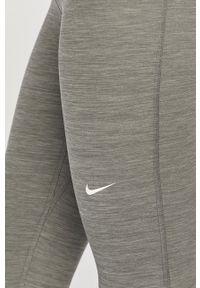 Nike - Legginsy. Kolor: szary. Materiał: tkanina, dzianina, skóra, włókno. Technologia: Dri-Fit (Nike)