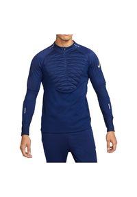 Koszulka męska piłkarska Nike Therma Strike Warrior DC9156. Materiał: tkanina, materiał, poliester. Długość rękawa: długi rękaw. Długość: długie. Sport: piłka nożna