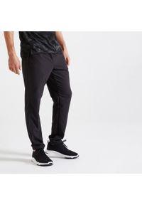 DOMYOS - Spodnie fitness męskie Domyos 120. Materiał: materiał, poliester. Sport: fitness