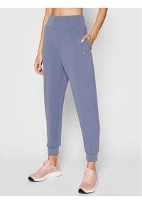 4f - 4F Spodnie dresowe H4L21-SPDD011 Niebieski Regular Fit. Kolor: niebieski. Materiał: dresówka