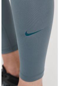 Zielone legginsy Nike z podwyższonym stanem, gładkie