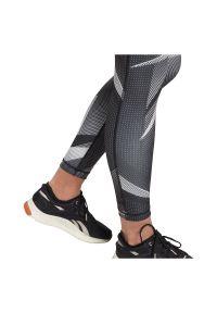 Spodnie legginsy treningowe damskie Reebok Myt Aop Gl2524. Materiał: elastan, dzianina, poliester. Wzór: nadruk. Sport: fitness