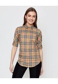 Burberry - BURBERRY - Bawełniana koszula w kratę. Kolor: beżowy. Materiał: bawełna. Wzór: kratka, aplikacja. Styl: klasyczny, elegancki, vintage