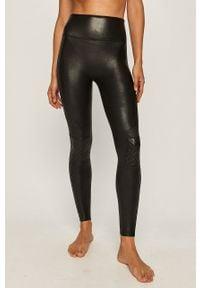 Spanx - Legginsy. Stan: podwyższony. Kolor: czarny. Materiał: elastan, skóra, dzianina, nylon. Wzór: gładki #1