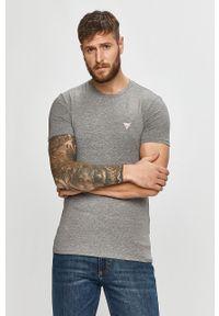 Szary t-shirt Guess Jeans na co dzień, casualowy, z aplikacjami