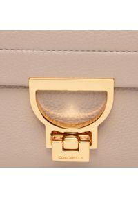 Beżowa torebka klasyczna Coccinelle skórzana