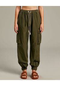 PALM ANGELS - Zielone spodnie cargo. Kolor: zielony. Długość: długie. Wzór: aplikacja