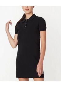 THE MARC JACOBS - Czarna tenisowa sukienka polo. Typ kołnierza: polo. Kolor: czarny. Materiał: dzianina. Typ sukienki: proste, sportowe. Styl: sportowy. Długość: mini