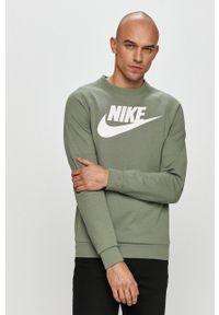 Nike Sportswear - Bluza. Okazja: na co dzień. Kolor: zielony. Długość rękawa: raglanowy rękaw. Wzór: nadruk. Styl: casual