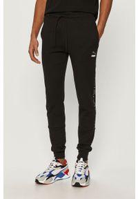 Czarne spodnie dresowe Puma z aplikacjami