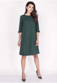 Zielona sukienka Nommo mini, z kokardą