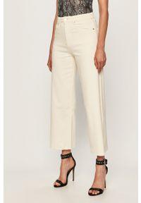 Kremowy jeansy loose fit TALLY WEIJL w kolorowe wzory