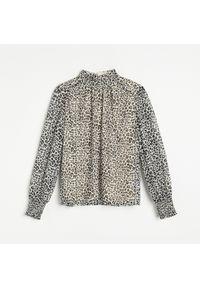 Beżowa bluzka Reserved z motywem zwierzęcym