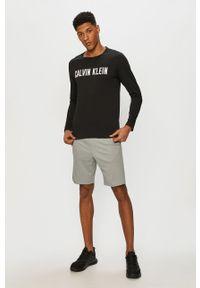 Czarna koszulka z długim rękawem Calvin Klein Performance na co dzień, z nadrukiem