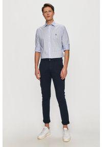 Guess - Spodnie. Kolor: niebieski. Materiał: tkanina