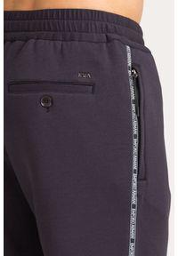 Spodnie dresowe Emporio Armani z aplikacjami