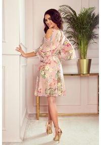Numoco - Zwiewna szyfonowa sukienka w kwiaty rozcięte rękawy. Materiał: szyfon. Długość rękawa: krótki rękaw. Wzór: kwiaty
