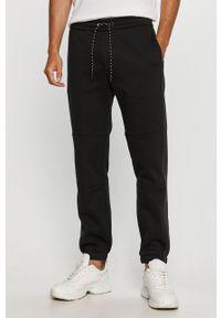 Czarne spodnie dresowe Armani Exchange z aplikacjami
