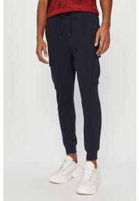 Niebieskie spodnie dresowe 4f