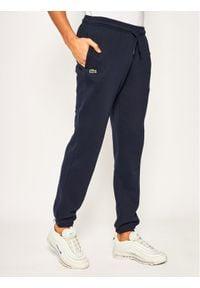 Lacoste Spodnie dresowe XH7611 Granatowy Regular Fit. Kolor: niebieski. Materiał: dresówka