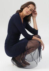 Born2be - Granatowa Sukienka Nerigale. Kolor: niebieski. Materiał: tiul, dzianina, materiał. Wzór: gładki. Typ sukienki: kopertowe. Styl: klasyczny, elegancki. Długość: midi