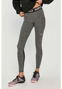 Szare legginsy Nike z nadrukiem
