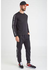 Spodnie dresowe Armani Exchange z nadrukiem