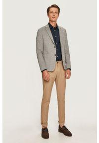 TOMMY HILFIGER - Tommy Hilfiger - Spodnie. Kolor: beżowy. Materiał: tkanina. Wzór: gładki