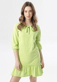 Born2be - Limonkowa Sukienka Morgalla. Typ kołnierza: kokarda. Materiał: dzianina. Długość rękawa: długi rękaw. Sezon: jesień, wiosna. Typ sukienki: proste. Długość: mini