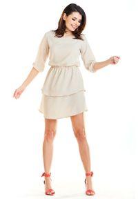 Beżowa sukienka wizytowa Awama mini, z falbankami