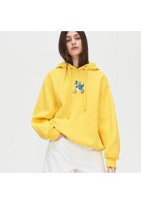 Żółta bluza Cropp z motywem z bajki
