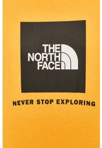 Pomarańczowy t-shirt The North Face z nadrukiem, z okrągłym kołnierzem