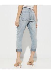 ONETEASPOON - Jeansy z dziurami Saints Low Waist. Stan: obniżony. Kolor: niebieski. Długość: długie. Wzór: aplikacja. Styl: klasyczny, rockowy