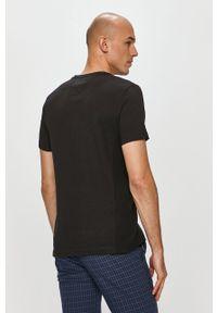 TOMMY HILFIGER - Tommy Hilfiger - T-shirt. Okazja: na co dzień. Kolor: czarny. Materiał: dzianina. Wzór: gładki. Styl: casual
