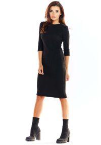 Awama - Czarna Ołówkowa Sukienka Midi z Prążkowanej Dzianiny. Kolor: czarny. Materiał: dzianina, prążkowany. Typ sukienki: ołówkowe. Długość: midi