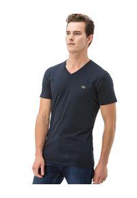 Lacoste - LACOSTE - Granatowy t-shirt z bawełny. Typ kołnierza: dekolt w serek. Kolor: niebieski. Materiał: bawełna. Wzór: haft. Styl: sportowy