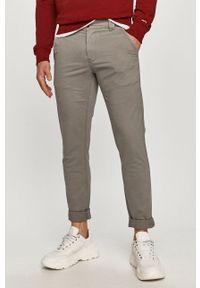 Tommy Jeans - Spodnie. Kolor: szary. Materiał: tkanina. Wzór: gładki