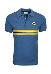 Lacoste - LACOSTE - Niebieski t-shirt polo. Typ kołnierza: polo. Kolor: niebieski. Materiał: bawełna. Wzór: kolorowy. Styl: klasyczny, retro