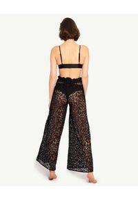 MISSION SWIM - Koronkowe spodnie Alina. Okazja: na plażę. Stan: podwyższony. Kolor: czarny. Materiał: koronka. Wzór: ażurowy, koronka. Styl: wakacyjny