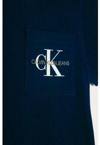 Niebieski t-shirt Calvin Klein Jeans z nadrukiem, casualowy, na co dzień