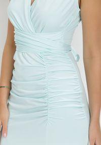 Born2be - Miętowa Sukienka Parthastos. Kolor: miętowy. Materiał: dzianina, materiał. Długość rękawa: na ramiączkach. Wzór: gładki, aplikacja. Typ sukienki: kopertowe. Długość: maxi