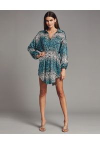 RETROFETE - Sukienka w print geparda Leopard. Kolor: biały. Materiał: jedwab. Wzór: nadruk. Typ sukienki: asymetryczne. Styl: klasyczny. Długość: mini