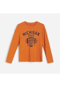 Pomarańczowa koszulka z długim rękawem Reserved z nadrukiem